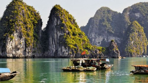 Unforgettable Trips Asia boats and mountainous islands
